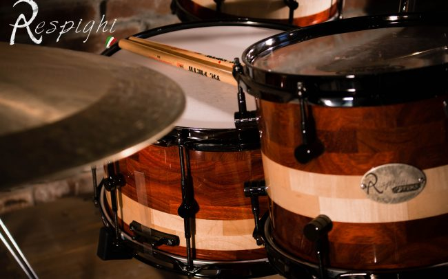 Detail of a Respighi Drums handmade drumset in padouk and maple